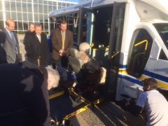 Leg. Al Krupski reviewing busses